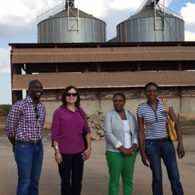 USAID Southern Africa's Evans Chinembiri, the Department of State's Janet MacLaughlin and Benita Gunn, and USAID Mozambique's Elsa Mapilele visit Arbelio Grain Storage and Processing in Chimoio, Mozambique